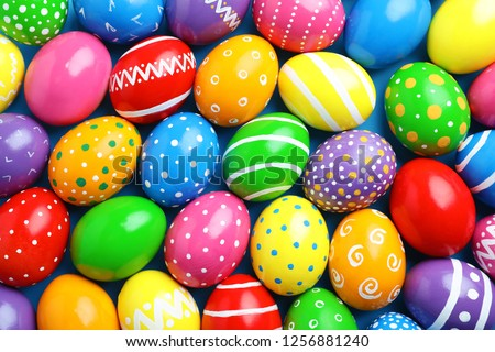 Many decorated Easter eggs as background, top view. Festive tradition #1256881240