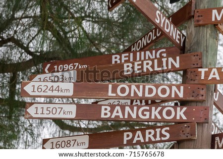 many destinations town sign wood pole in polynesia #715765678