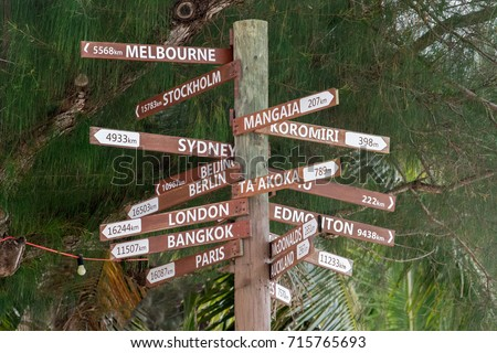 many destinations town sign wood pole in polynesia #715765693