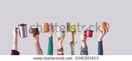 Many different arms raised up holding coffee cup - Shutterstock ID 1040305813