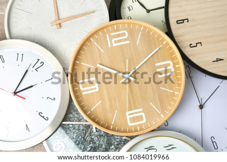Many different clocks, top view. Time change concept