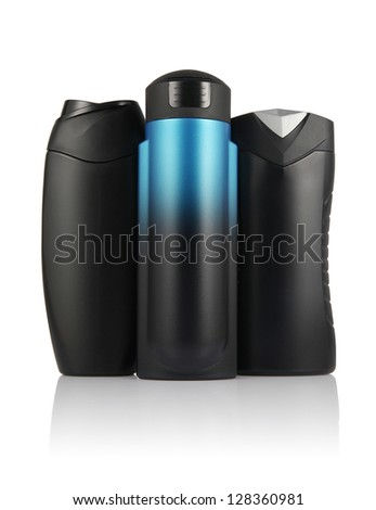 Many different color tubes and bottles for hygiene, health and beauty on a white background with reflection isolated, for man