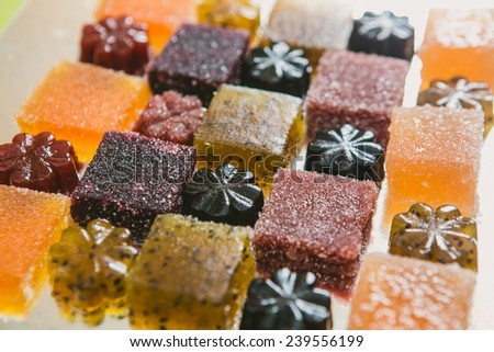 Many different fruit paste candies. Whole background. Selective focus. warm colors