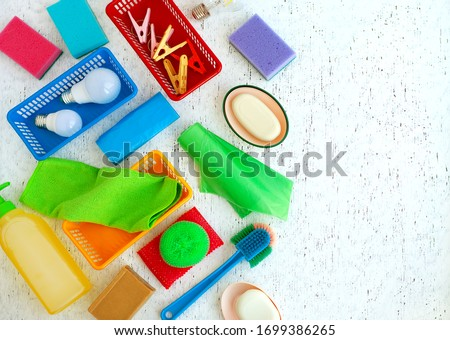 Many different household items. Cleanliness items on a white texture background. Household items of various kinds are arranged in a chaotic manner. stock photo