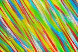 Many different multi-colored lines are chaotically drawn with brush on white canvas background. Art backdrop close-up. Abstract colored line brush painted randomly on white background. Bright colorful