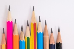 Many different muticolored pencils on white background.Difference concept.