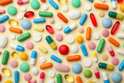 Many different pills on color background, flat lay