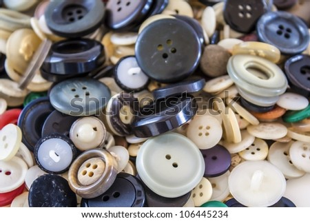 Many different sized colored and shaped buttons