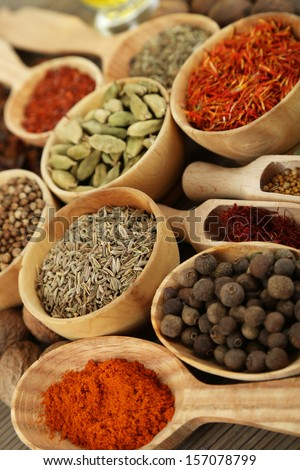 Many different spices and fragrant herbs close-up background