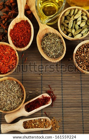 Many different spices and fragrant herbs on wooden table close-up