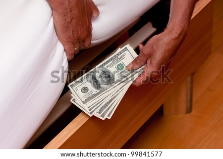 many dollar bills are hidden under the bed