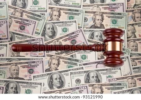 many dollar bills with gavel. legal fees - legal fees.