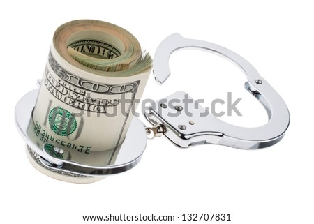 many dollar bills with handcuffs