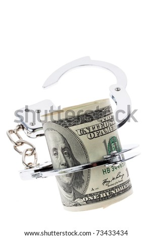 Many dollar bills with handcuffs. isolated on white