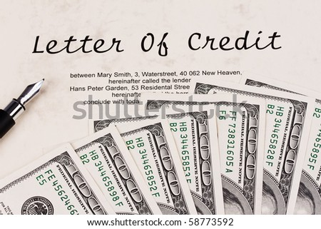 Many dollars bills and English credit - stock photo