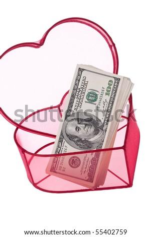 Many dollars bills in a heart