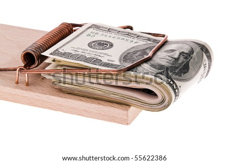 Many dollars bills in a mousetrap