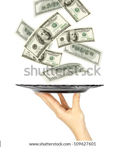 Many dollars falling on kitchen plate on womans hand