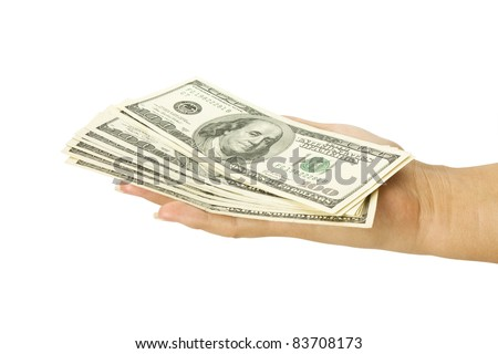 Many dollars falling on womans hand with money