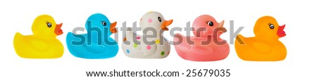 Many ducks toy of different colors on a over white background