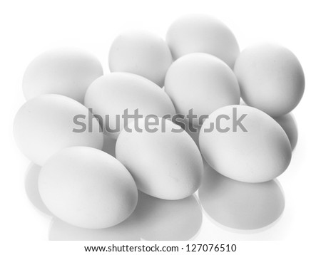 Many eggs isolated on white