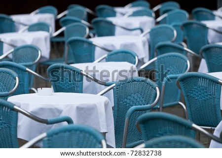 Many empty chairs in outdoor restaurant