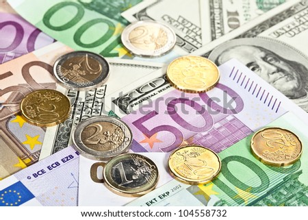 Many euro and dollar banknotes and coins, money background