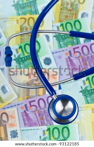 many euro bank notes with a stethoscope. health costs.