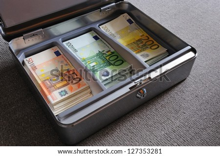 Many 50, 100, 200 Euro banknotes in metal security box