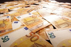 Many euro banknotes spread all over. Wealth and economy concept