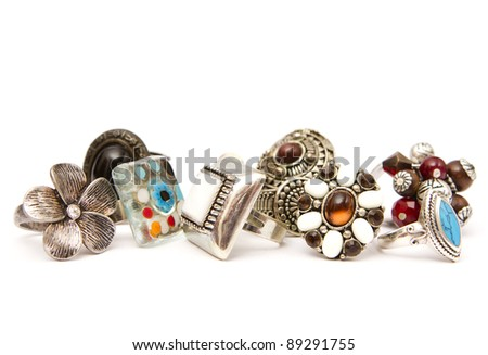 Many fashion silver rings on a white background