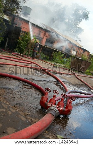 Many fire hoses bring water for fire extinguishing