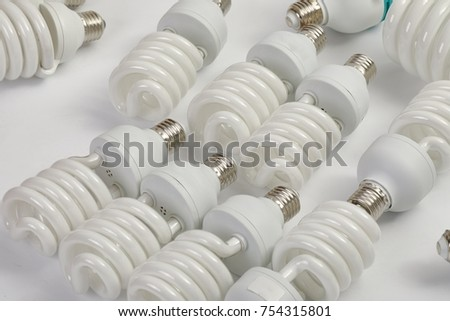 Many fluorescent lightbulbs in a pile