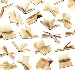 Many flying books as background isolated on white