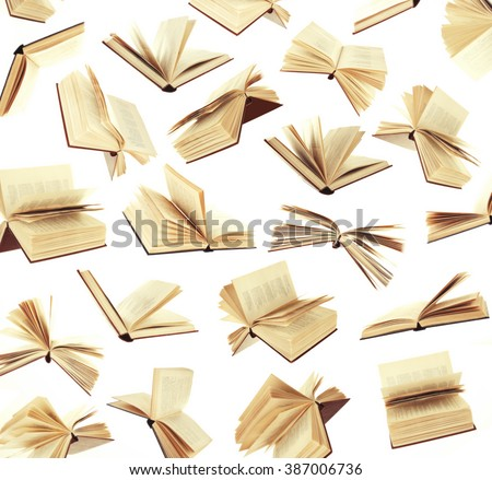Many flying books as background isolated on white