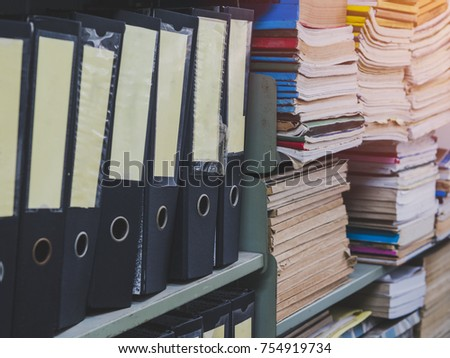 Many folder and files folder store in the office shelf #754919734