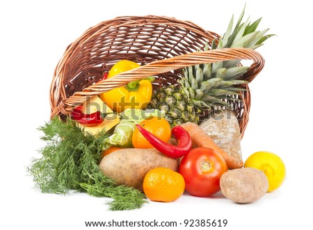 Many food in shopping basket isolated on white background