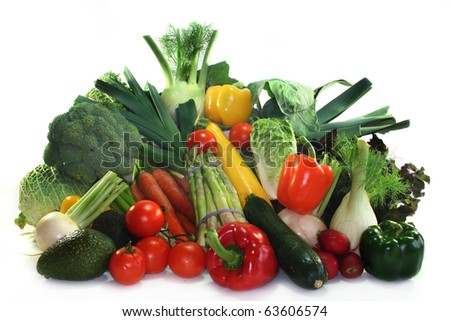 Many fresh different types of vegetables stacked in a pile stock