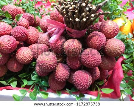 Many fresh lychees in market   #1172875738