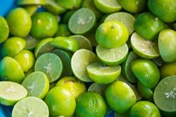 Many fresh ripe limes slice