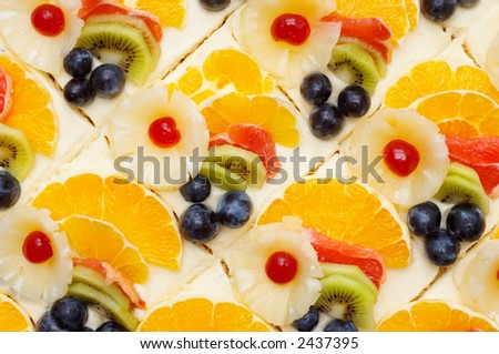 many fruit cakes with custard. suitable as background.