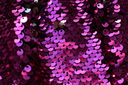 Many fuchsia sequins shining background