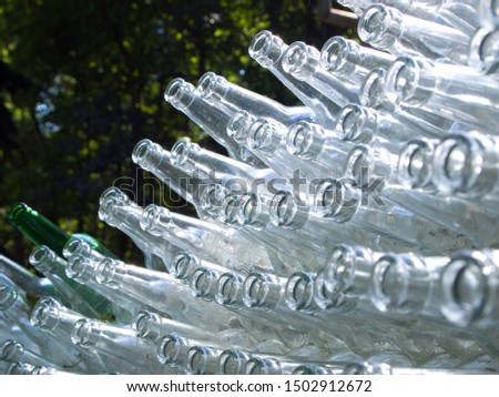 Many glass bottles piled in a pile.