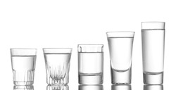 Many glass of vodka isolated on white
