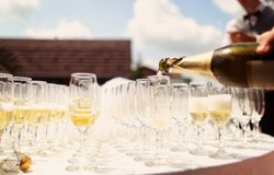 Many glasses of champagne on table
