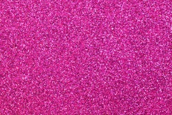 many glitter on the glittery magenta fuchsia background ideal as a backdrop