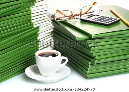 Many green folder with cup of coffee closeup