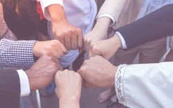 Many hand of business people join respect  teamwork Concept partnership touching hands promise for trust mind team. All of people promise to do honesty business. Business Team reach an agreement .