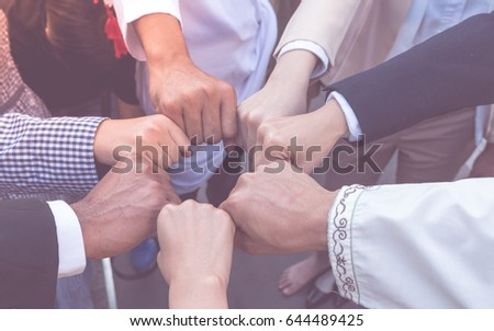 Many hand of  business people join respect  teamwork Concept partnership touching hands promise for trust mind team. All of people promise to do honesty business.