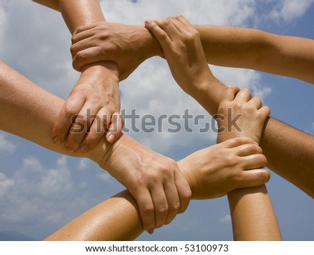 Many hands connecting to a chain with sky